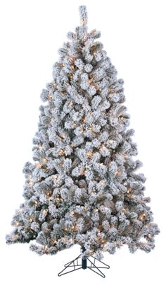 7 pre lit flocked green montana artificial christmas tree with clear lights image httpsbassproscene7comisimagebasspro2362824_168700_is - Artificial Christmas Tree Reviews